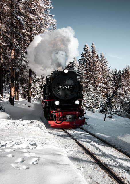 Front view of a steam train in the snow