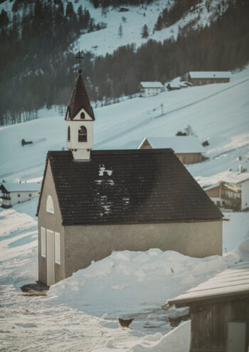 Church is snow covered village