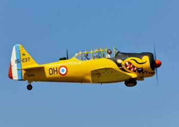 Old propeller plane with teeth livery in flight