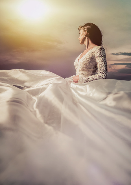 Bride wearing floaty dress at sunset