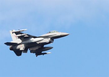 F16 fighter jet carrying missiles