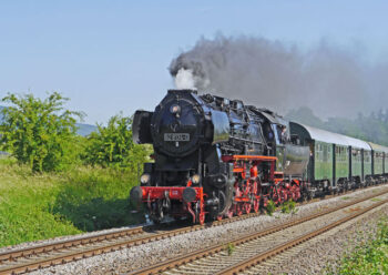 Close up of a steam train and carriages