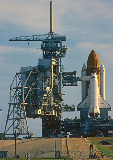 Space shuttle at dock awaiting launch