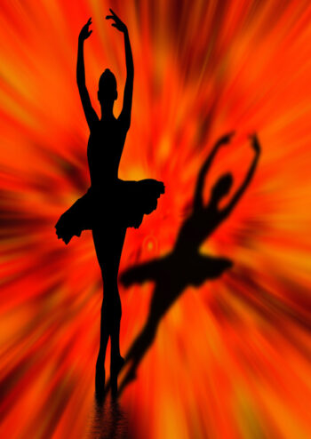 Silhouette of ballerina with orange background