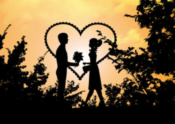Silhouette of male and female in woodland