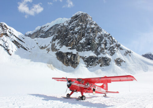 Propeller plane on a snowy mountain