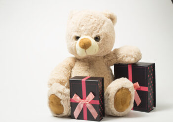 Teddy bear with boxed presents