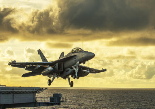 F18 fighter jet taking off from aircraft carrier