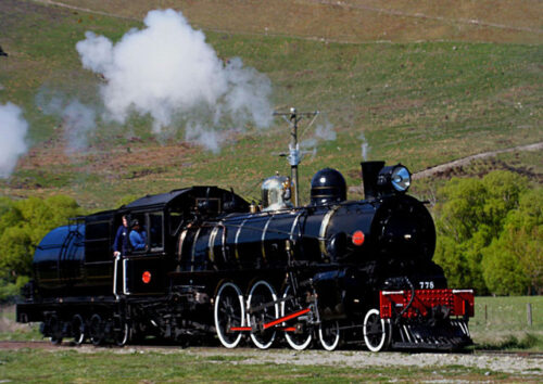 Side view of steam train