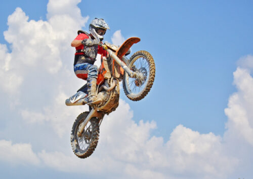 Motorbike and rider in the air