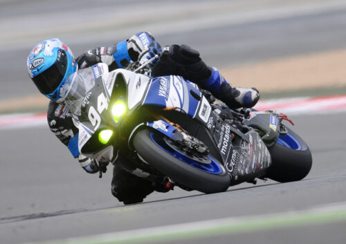 Blue racing motorbike leaning into a corner
