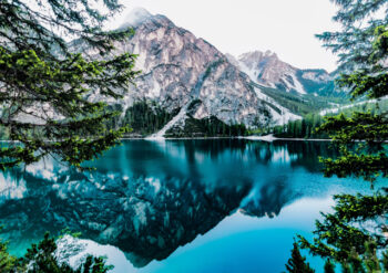 Reflection of mountain in blue water