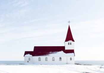 White church with red roof in the snow