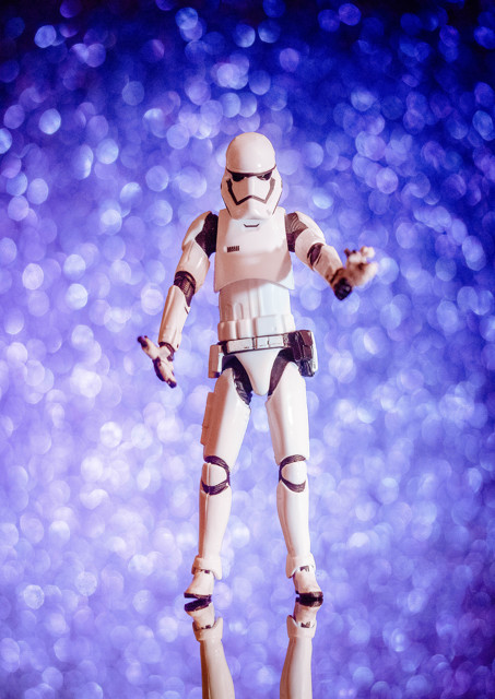 Storm trooper toy with purple and white background