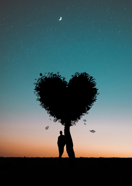 Fantasy image of male standing under a heart shaped tree