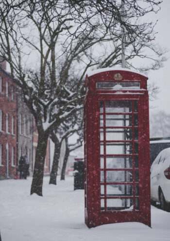Red telephone box in the snow