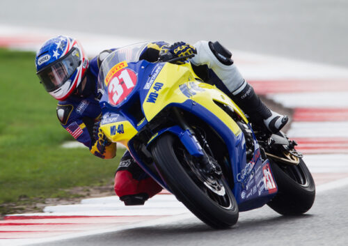 Yellow and blue racing motorbike on track
