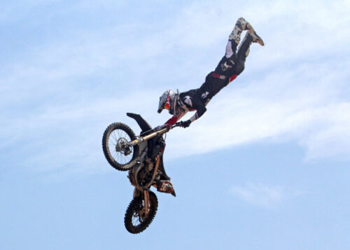 Motorbike and rider mid air