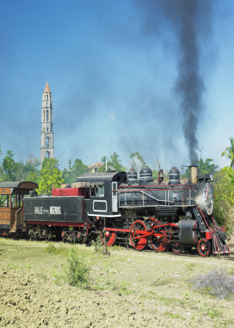 Steam train passing by town